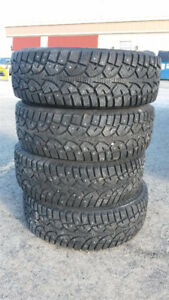 4 Studded Winter Tires From MAZDA 3 2007 (195/65-R15)