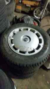 3  SETS OF VOLVO STEEL WHEELS WITH GREAT SNOWS TEXT