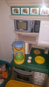 Toy kitchen with accessories