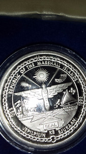 FIFTY DOLLAR REACHING FOR THE STARS SILVER COIN