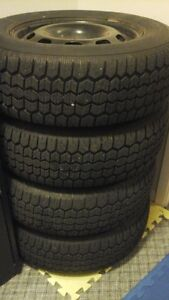 5x100 subaru outback rims and tires WINTER TIRES London Ontario image 1