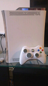 I am selling my l Xbox 360 in good condition with a wirel