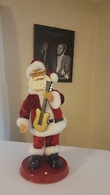 """Singing Old Time Rock & Roll And Dancing Santa With Guitar In Hand. 18"""" Tall."""