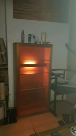 Wooden cabinet with glass door and light