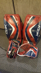 "Rbk 6K JR 27"" goalie pads with glove and blocker."
