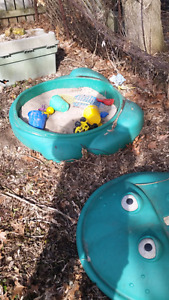 Plastic frog sandbox and toys