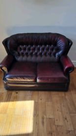 Chesterfield style sofa, rocking chair and foot rest.