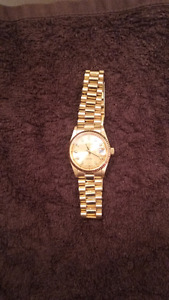 Gold tone Geneva watch with Sapphire accents on numbers
