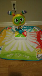Learning singing lights up play mat