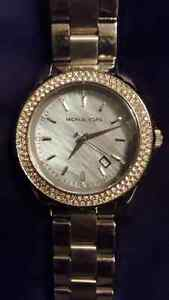 Michael Kors watches and purse and Nixon watch
