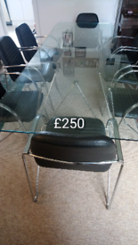 3m glass boardroom/dining room table and Italian made chairs