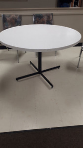 multiple round tables and chairs