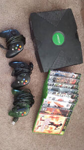XBOX with dance mats, 3 controllers, and assorted games.