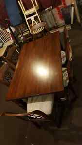 Solid wood & wrought iron dining room table with chairs