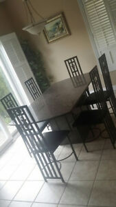 Real solid granite table. And granite base. 6 chairs