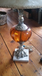 Vintage amber glass ornate lamp on marble base