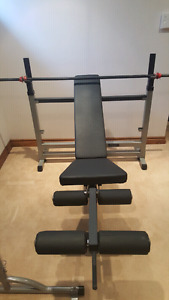 ON HOLD workout bench with leg excersiser and barbell
