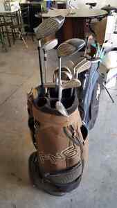Golf bags and clubs x 2