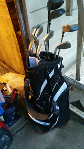 golf clubs and new self standing bag 60$ obo