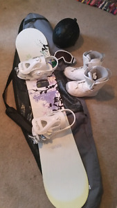 Woman's snow board and accessories