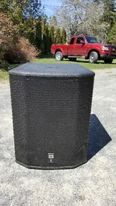 Two JBL PRX 618S XLF powered subwoofer with covers