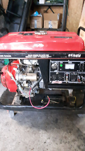 generator, tools, tires, trailer tire on rim, amp and boom box,