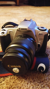 35mm Canon Rebel w 2 lens & instruction book
