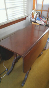 "Duncan Phyfe Table 53"" x 39"" with sides dropped. In good shape."