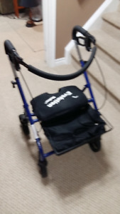 Evolution 4 Wheel Walker c/w Basket and Pouch. Folds down for e