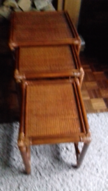 Nest of three cane tables nice condition fit inside each other