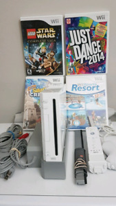 Nintendo Wii System bundle with 4 Games.