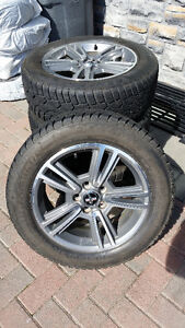 Mustang OEM alloy wheels mounted on snow tires. Great Condition