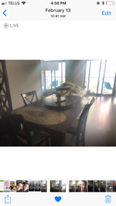 vintage style wood table with extension and 5 wood chairs