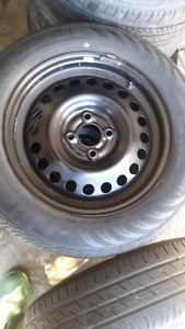 four 185/65/15 all season w/steel wheels 2014 Nissan Versa Note