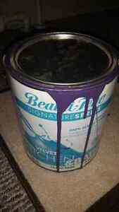 90% full can of paint (teal and purple)