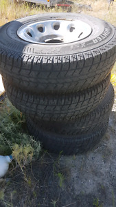 Arctic claw LT235/85R16 snow tires with rims