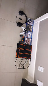 PlayStation 4 includes 4 games and 2 good condition controllers