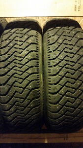 Pair of Nordic winter tires 215/75/15 with studs - $140 installd