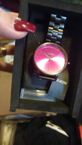 Black Nixon watch with pink face