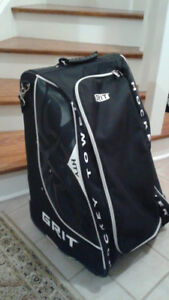 Grit Rolling Hockey Bag and Size 4 Bauer Hockey Skates for sale