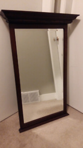 Solid wood mirror with decorative crown