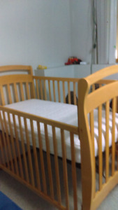 Wooden crib with mattress and 2 cover mattess