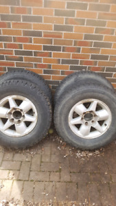 4 tires 245/70R16  and rims included.