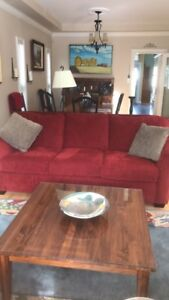 red sofa and two matching chairs