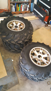 """4 can am outlander rims and 26"""" tires"""
