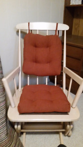 Relax in this solid wood glider/rocking chair