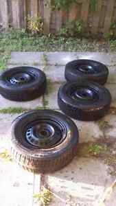 """Set of Four 14"""" Michelin X-Ice tires with winter rims"""