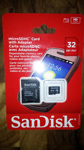 Brand new SanDisk 32GB micro SD card with adapter