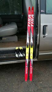 Skis size 2 boots and poles