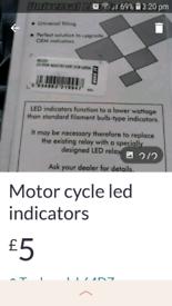 Motor cycle led indicators an handlebar grips both universal